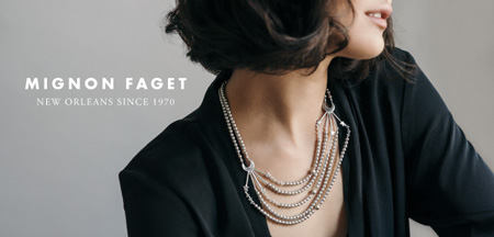 Mignon Faget woman in black top neckline with jeweled necklace